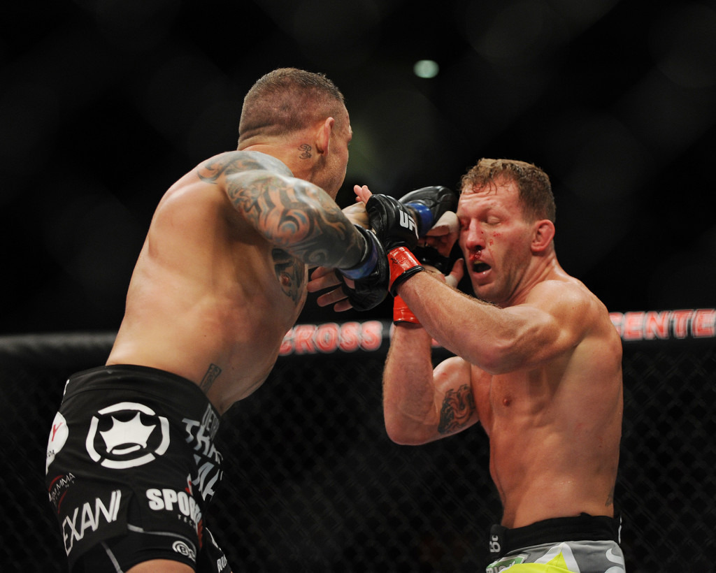 Gray Maynard, red gloves, and Ross Pearson, blue gloves, square off in a lightweight bout. Kevin Bennett/Special to the Telegram
