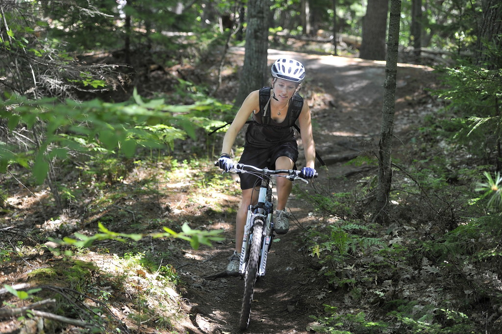 Laura Mahoney of Brunswick enjoys mountain biking the rugged Yarmouth part of the trail.