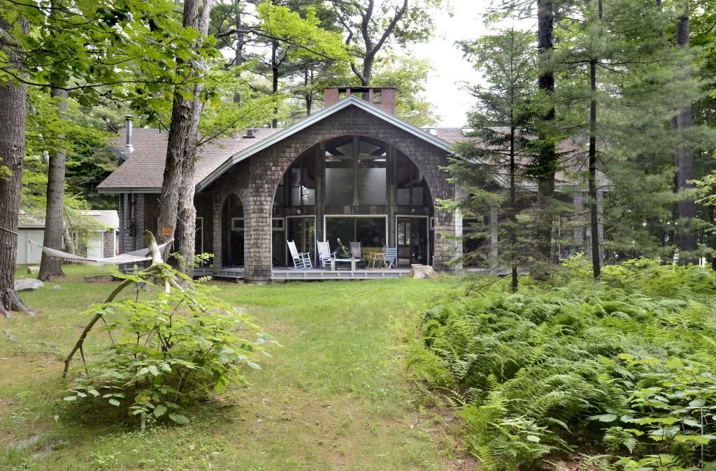 The 3,100-square-foot seasonal cottage has five bedrooms, three and a half bathrooms, three fireplaces, septic and sewer service, well water and a gas-fired generator for power.