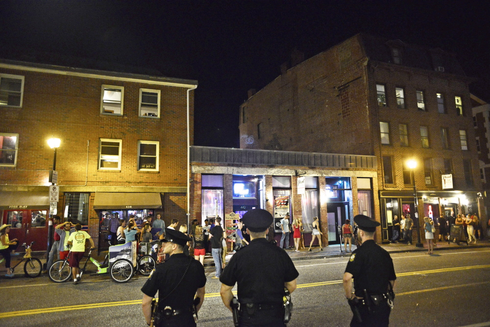Police officers keep an eye on activities in Portland's Old Port just after 1 a.m. Sunday, July 6, following the Independence Day celebration and fireworks Saturday night. The odds of being assaulted in Portland are highest between 1 and 2 a.m.