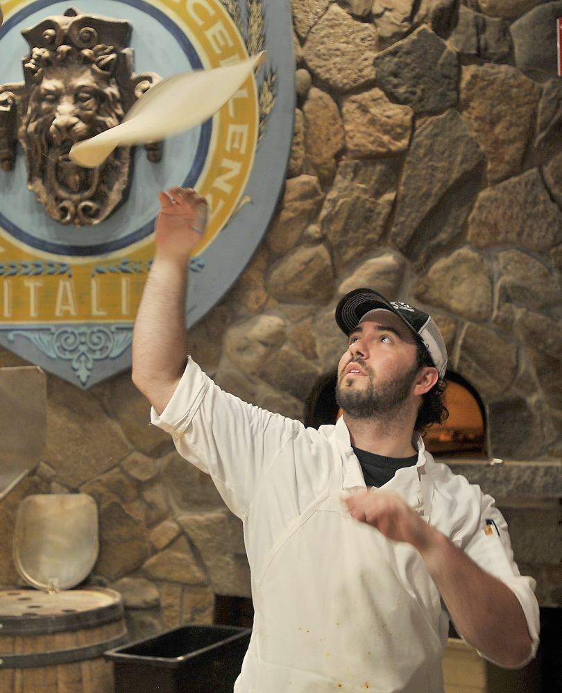 Noah DiLeo spins a pizza crust at Tuscan Bistro.