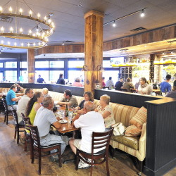 Tuscan Brick Oven Bistro in Freeport offers a cool, wide-open space with comfortable banquette seating.