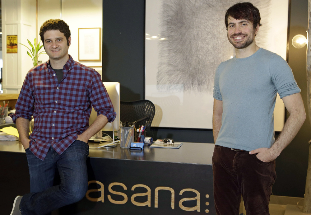 "Asana co-founders Dustin Moskovitz, left, and Justin Rosenstein are shown at the company's headquarters in San Francisco. ""We are trying to make all the soul-sucking work that comes with email go away,"" Rosenstein says."