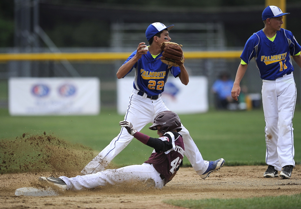 Joshua LeFevre of Falmouth forces out Conor O'Connell of Goffstown, New Hampshire, at second base.