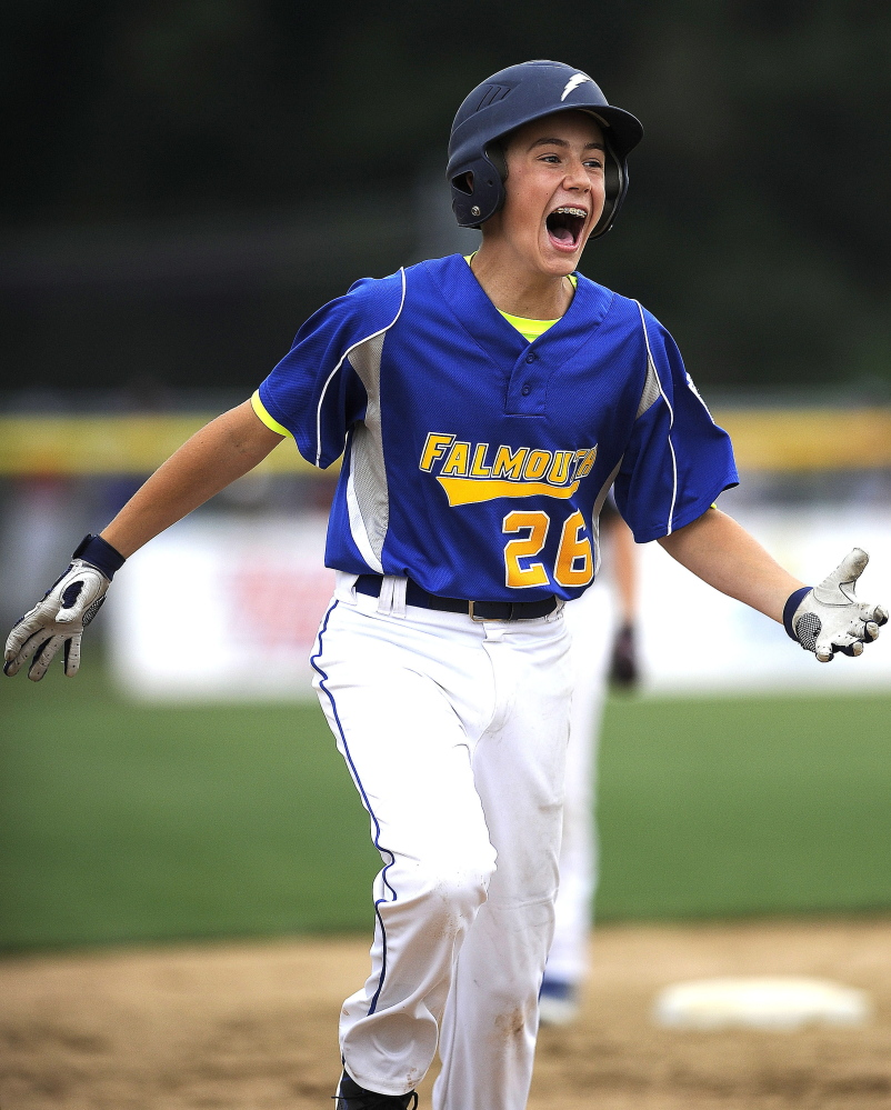 Falmouth's Alexander Smith rounds third base after hitting a game-winning two-run homer in the bottom of the sixth inning to defeat New Hampshire, 3-1, on Friday.