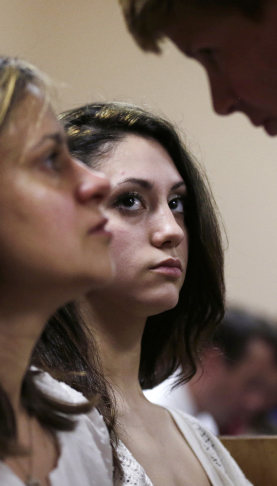 Abigail Hernandez, center, listens to her mother, Zenya Hernandez, left, talk with New Hampshire Senior Assistant Attorney General Jane Young on Tuesday.