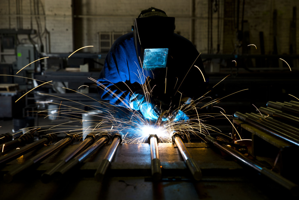 A welder fabricates anchor bolts for roads and bridges at the custom manufacturer Fox Co. Inc. in Philadelphia. Manufacturing added 28,000 jobs in July, the most in eight months. That was just one of the bright spots in a Labor Department report released Friday that showed employers had created 209,000 new jobs last month.