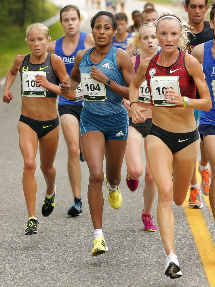 From left, elite women runners Jordan Hasay, (108), Aselefech Mergia (104), Gemma Steel (105) and Shalane Flanagan (102) lead a pack at about the halfway point of the 17th annual TD Beach to Beacon 10K in Cape Elizabeth on Saturday.