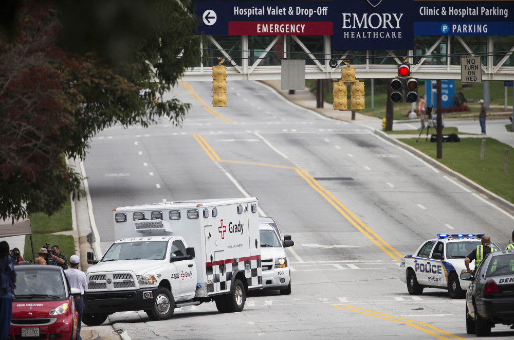 An ambulance carrying Dr. Kent Brantly arrives at Emory University Hospital in Atlanta on Saturday afternoon. Another American with Ebola is expected to join him at the hospital in a few days.