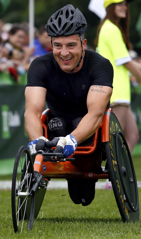 Tony Nogueira of New Jersey finishes first in the men's wheelchair division at the 17th annual TD Beach to Beacon 10k on Saturday.