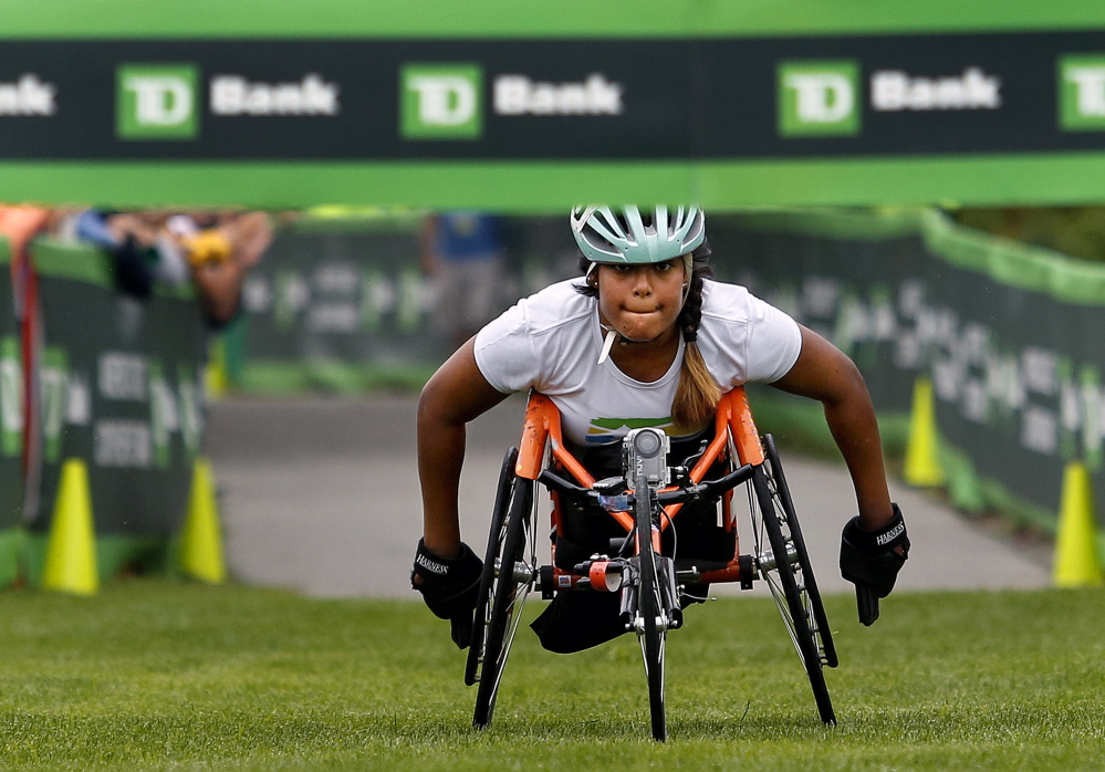Christina Kouros keeps her eyes on the finish line as she came in first, and was the only entrant, in the female wheelchair division at the 17th annual TD Beach to Beacon 10K on Saturday.