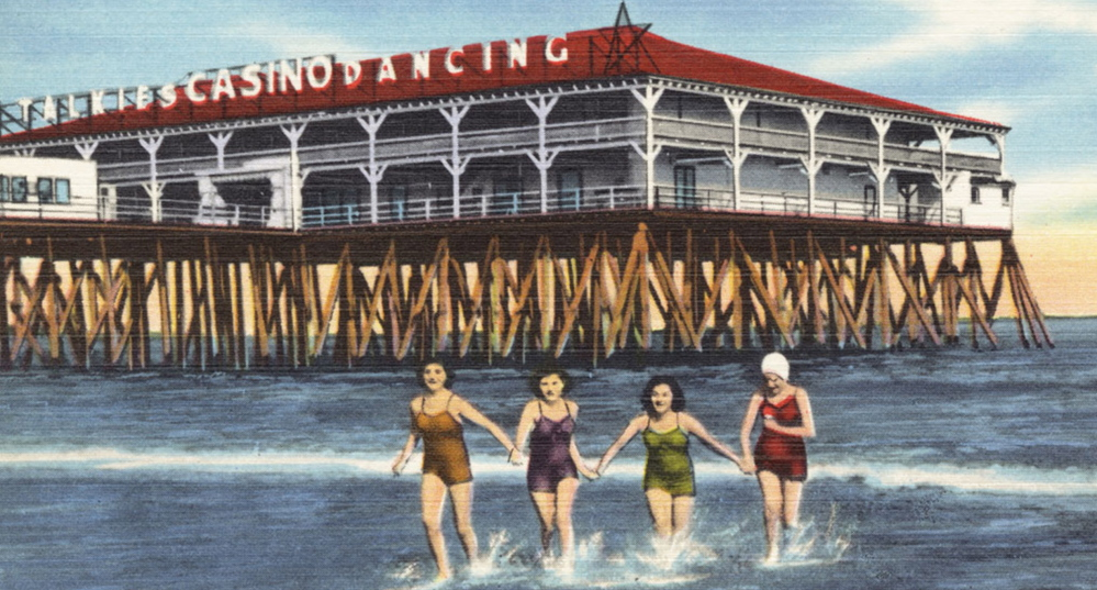 A historic postcard shows The Pier at Old Orchard Beach in the mid-20th century.
