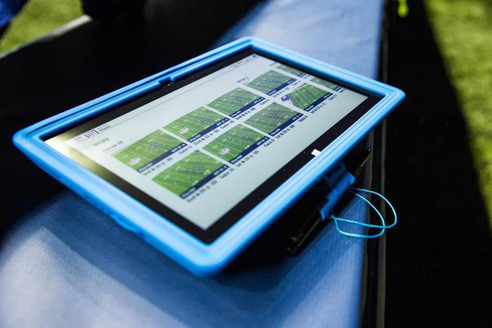 Surface tablets were allowed for the first time on the sideline of NFL football games during Sunday's Hall of Fame game in Canton, Ohio.
