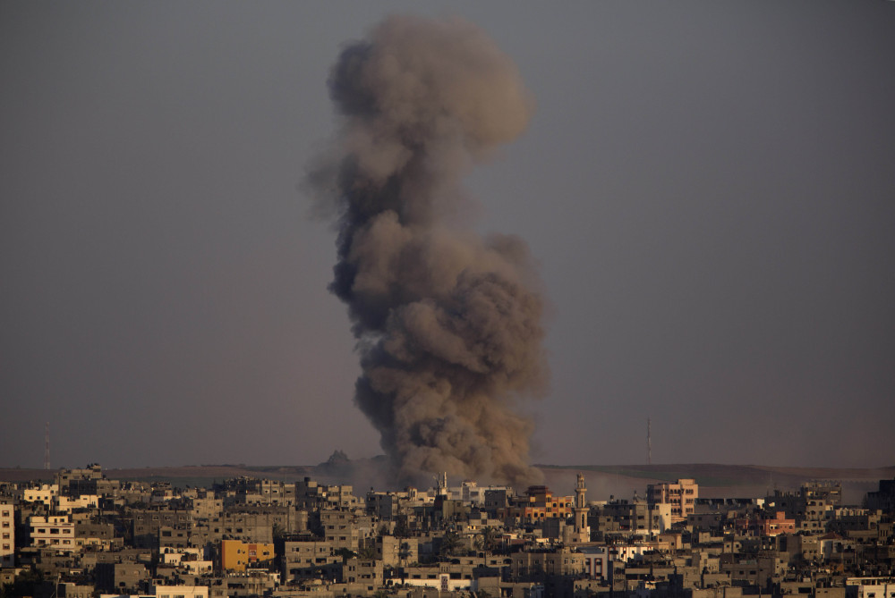 Smoke rises after an Israeli airstrike in Gaza City, Sunday.