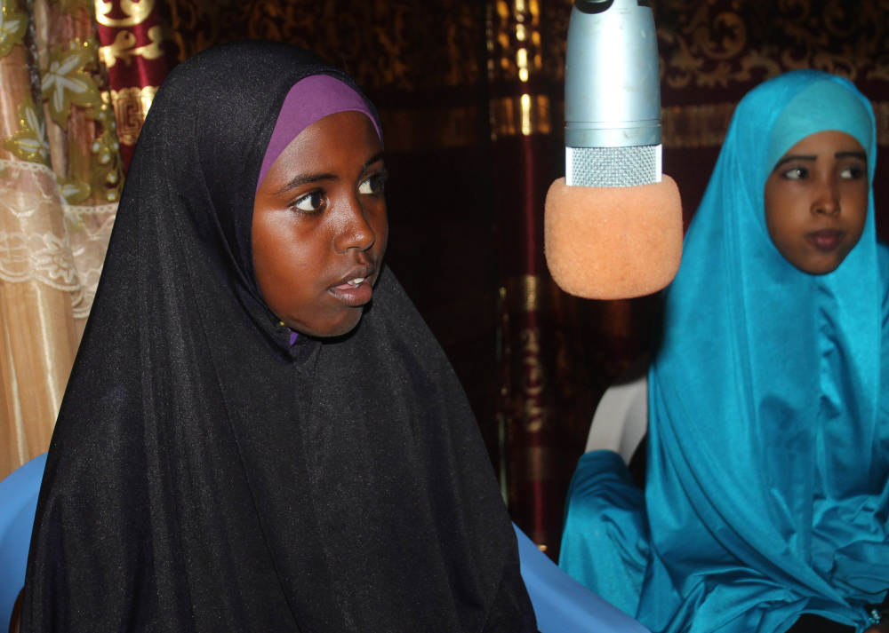 Sports fans get quizzed at Gool FM radio studio by a sports presenter as parts of a competition, in Mogadishu, Somalia. For decades Somalia's airwaves have been filled by radio stations broadcasting news of the country's long-running violence or troubled clan politics. But now Somalis can listen to a dedicated sports radio station. Gool FM airs sports only, no politics.