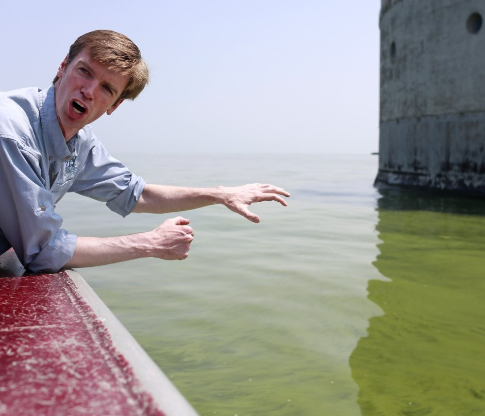 Collin O'Mara, president and CEO of the National Wildlife Federation, explains Sunday about the algae buildup in Lake Erie that has created toxins and a greenish coloration near Toledo's water intake facility.