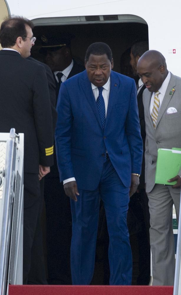 Yayi Boni, center, president of the West African nation of Benin, arrives Sunday at Andrews Air Force Base in Maryland for the U.S.-African Leaders Summit, a three-day event that begins Monday.