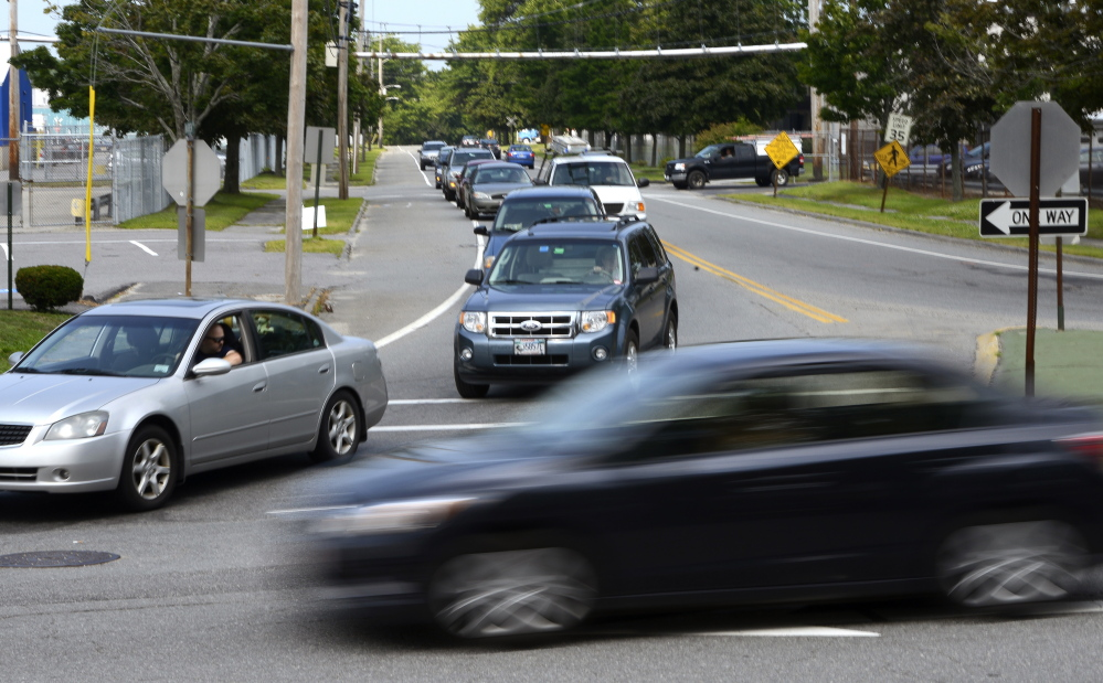 Vehicles back up on Warren Avenue as drivers try to merge into traffic on Cumberland Street in Westbrook during the afternoon commute Friday. There were 79 crashes from 2011 to 2013 at the intersection, the highest crash rate in Cumberland County.