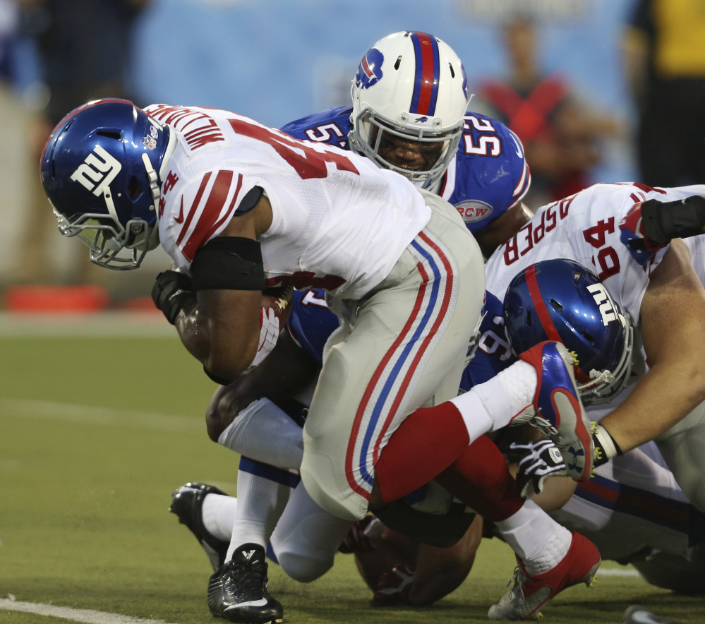 Giants running back Andre Williams powers into the end zone for a 3-yard touchdown run Sunday in a 17-13 preseason win over the Buffalo Bills in the Hall of Fame Game at Canton, Ohio.