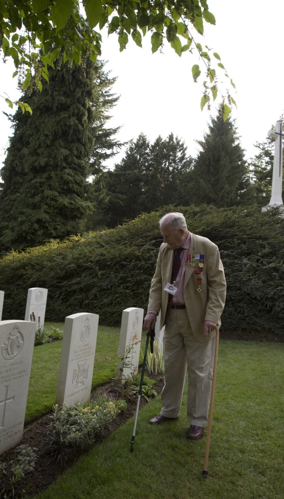 Former British Maj. Maurice French, 84, stands in front of the grave of his uncle, World War I Victoria Cross recipient Maurice Dease, during the ceremony Monday in Saint-Symphorien, Belgium.