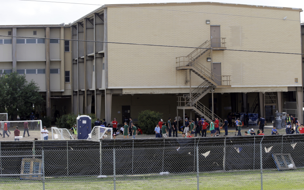 This file photo, taken June 23, shows a shelter at Lackland Air Force Base in San Antonio for unaccompanied minors who enter this country illegally. The government said Monday that it will soon close three shelters it established at military bases to house children caught crossing the border alone.