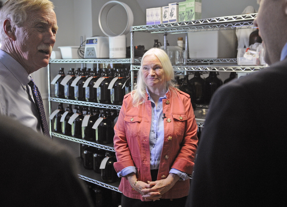 Maine Medicinals CEO Edie Johnston speaks Monday with Sen. Angus King, left, and U.S. Small Business Administration Regional Administrator Seth Goodall in Dresden.