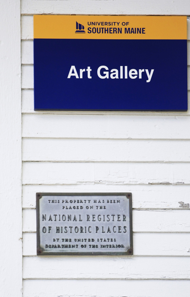 Preservationists feared that the USM art gallery would be removed from the National Register of Historic Places if vinyl siding was installed.
