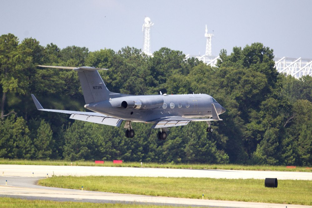 A private plane arrives at Dobbins Air Reserve Base transporting a second American missionary stricken with Ebola, Tuesday in Marietta, Ga.