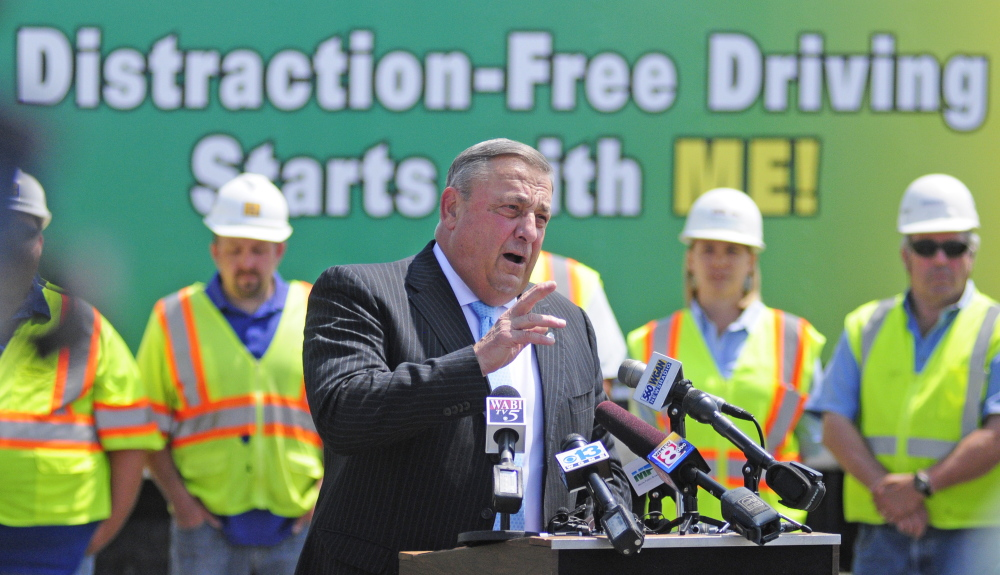 Gov. Paul LePage talks about distracted driving on Tuesday during a news conference in the parking lot outside State Police headquarters in Augusta.