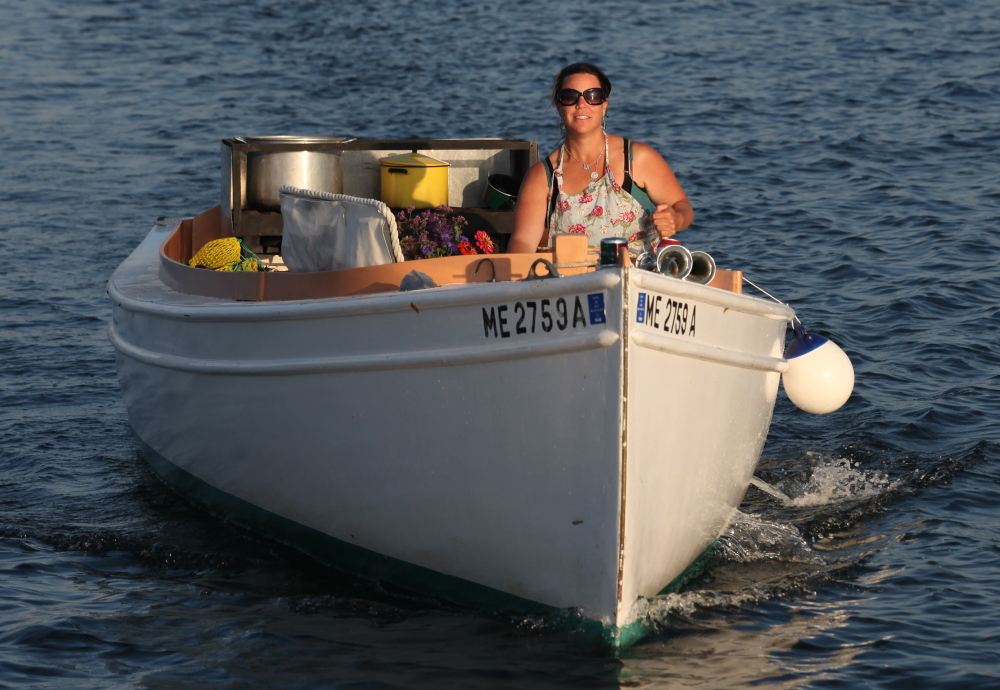 Reilly Harvey rund her boat Mainstay around the harbor between Dix Island and High Island.