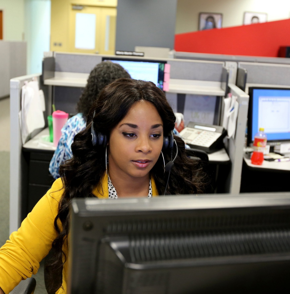 Detroit resident Carlettia Ellis, 24, works as a customer service representative at the Dialog Direct call center in Highland Park, Mich. The company, which employs about 800 people at its headquarters, plans to add 500 more jobs.