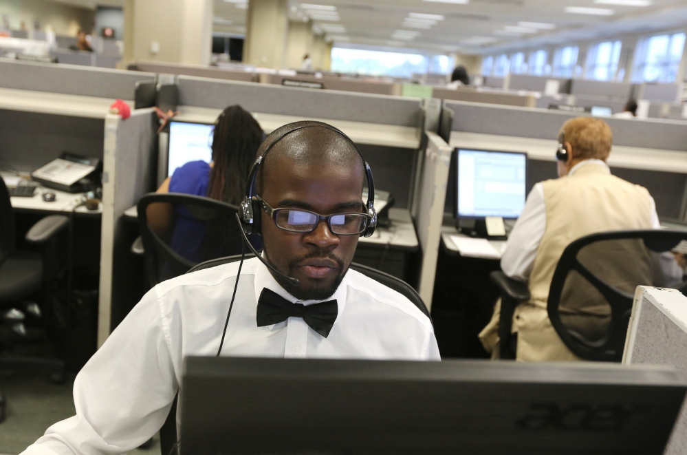 Detroit resident Keontay Kelley, 26, works as a customer service representative at Dialog Direct call center in Highland Park, Mich., on Wednesday, July 30, 2014. Kelley says he enjoys his job because he likes helping people. (Jessica J. Trevino/Detroit Free Press/MCT)