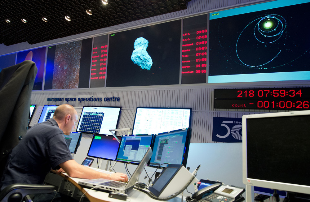 An expert watches his screens at the control center of the European Space Agency, ESA, in Darmstadt, Germany, Wednesday.