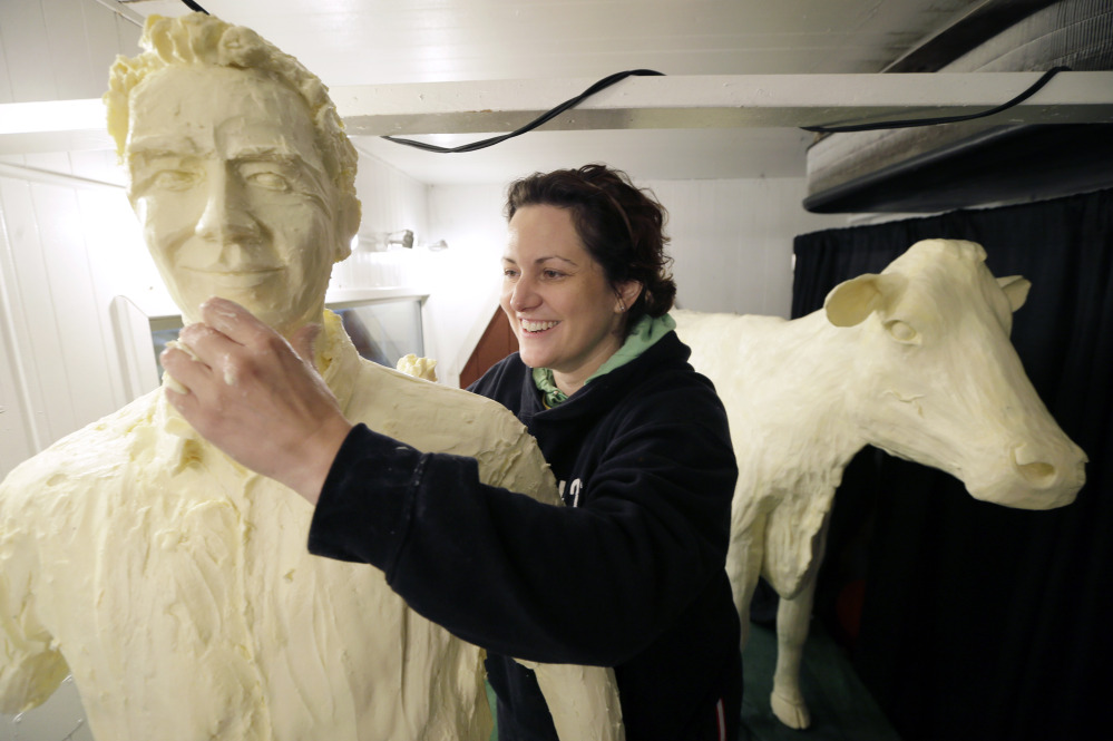 Sarah Pratt works on a butter sculpture of actor Kevin Costner on Wednesday on the eve of opening day of the Iowa State Fair in Des Moines. The