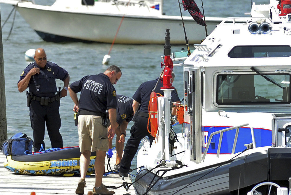 Police work at the scene of a boating accident near Old Greenwich Yacht Club at Greenwich Point, Conn., on Wednesday afternoon. The harbormaster said one girl was killed and another was seriously injured.