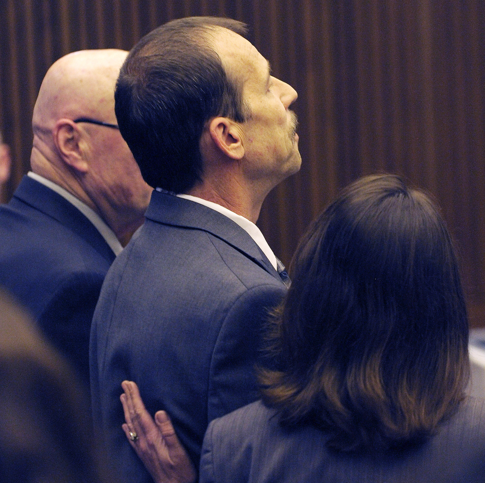Theodore Wafer stares straight ahead after being convicted of second-degree murder as his attorney Cheryl Carpenter comforts him on Thursday in Detroit.