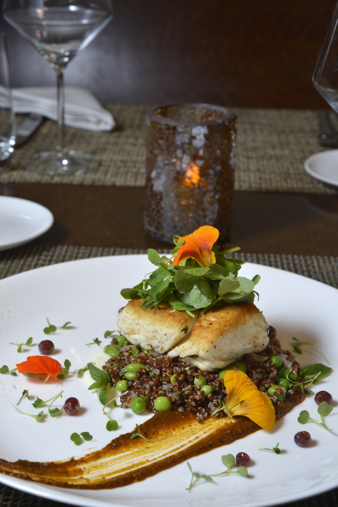 A restaurant review for Dine Out Maine. Grace restaurant on Chestnut Street in Portland. Pan seared East Coast Halibut with quinoa, peas, favas, mint yogurt, chernoula and grape salad. John Ewing/Staff Photographer
