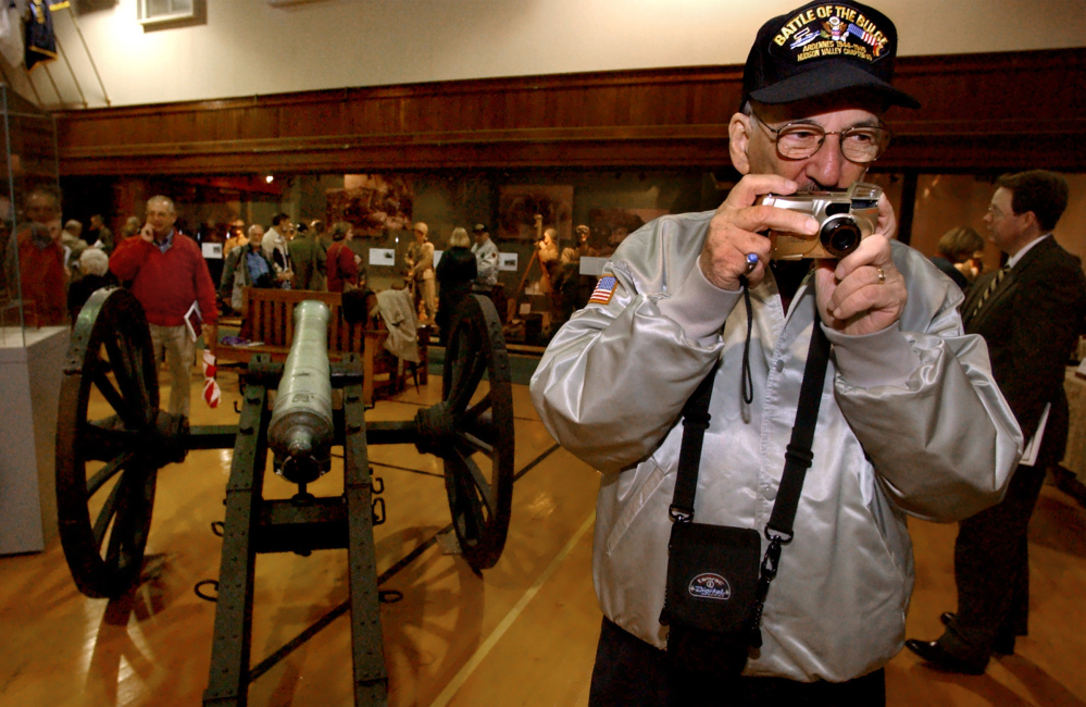 World War II veteran Richard Marowitz takes a picture of an exhibit on opening day in 2002 of the New York State Military Museum and Veterans Research Center in Saratoga Springs, N.Y. Marowitz, who found Adolf Hitler's top hat, died Wednesday. He was 88.
