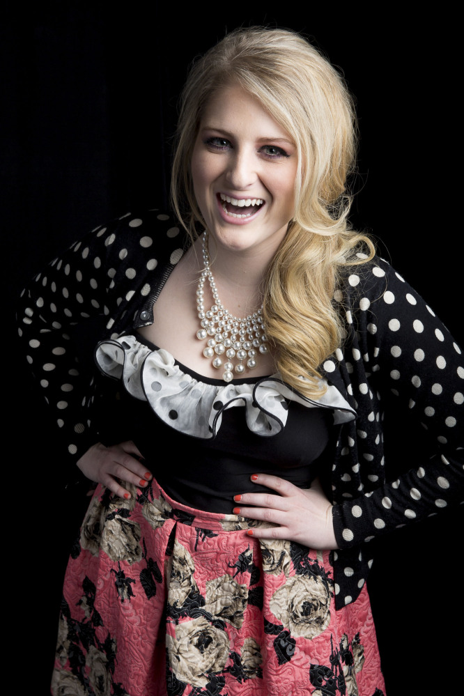 "Singer-songwriter Meghan Trainor, known for the pop single ""All About That Bass,"" poses for a photo Thursday in New York."