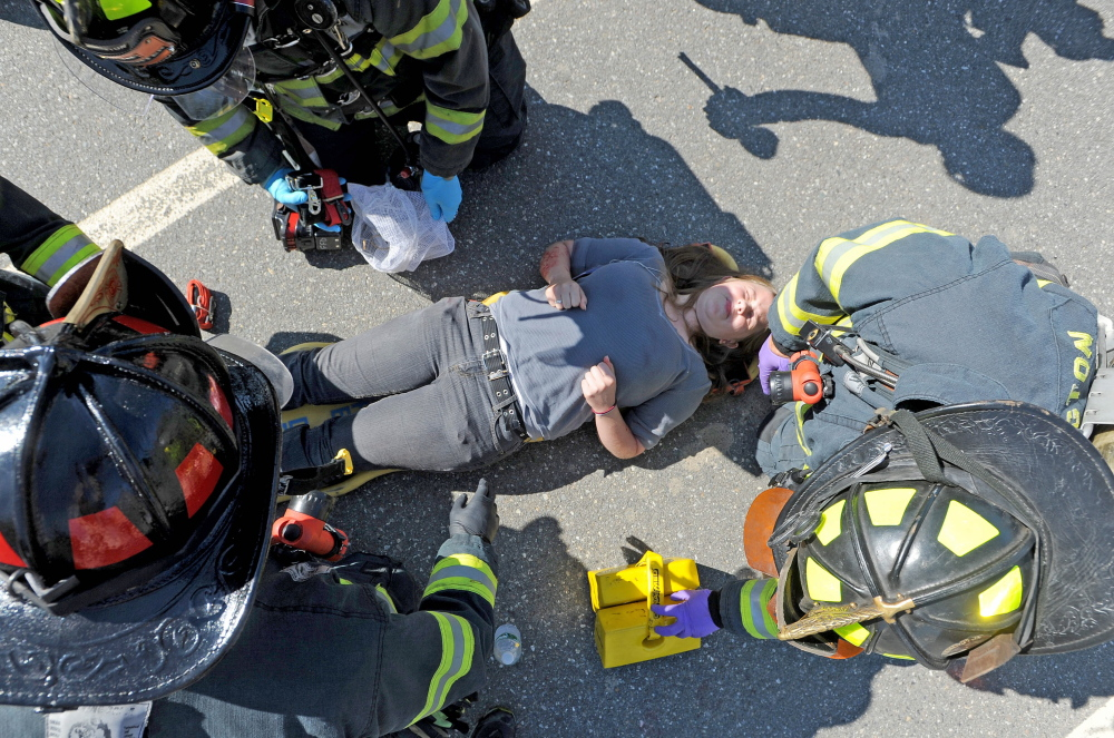 Farmington firefighters treat a person portraying a victim injured by a car bomb during a Homeland Security training exercise on Friday.