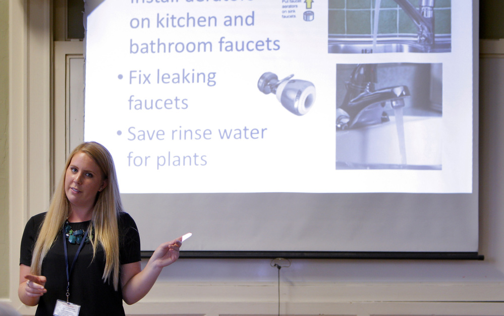 Dripping faucets can cost Santa Cruz residents dearly, as town official Amanda Bunte explains during a community meeting last month.