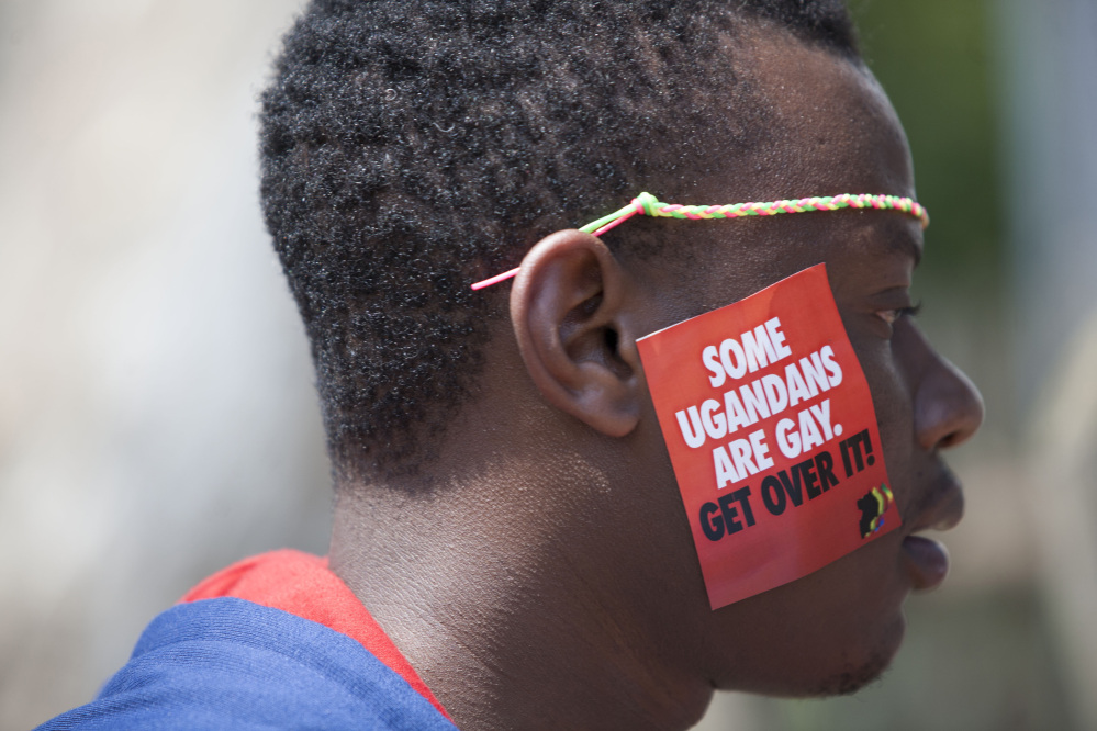 A Ugandan man is seen during the 3rd Annual Lesbian, Gay, Bisexual and Transgender Pride celebrations in Entebbe, Uganda, on Saturday. The parade is the first public gay pride event since a Ugandan court invalidated an anti-gay law that was widely condemned by some Western governments and rights watchdogs.
