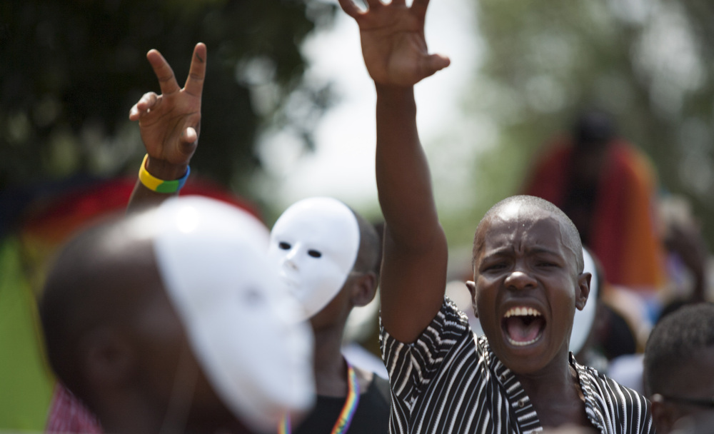 Ugandans march in the third annual Lesbian, Gay, Bisexual and Transgender Pride parade in Entebbe, Uganda, on Saturday.
