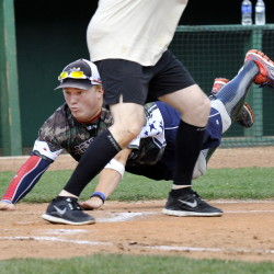 Wounded Warrior Joshua Wege slides head-first to score during Saturday's 18-14 victory over the Maine Army National Guard at The Ballpark in Old Orchard Beach.