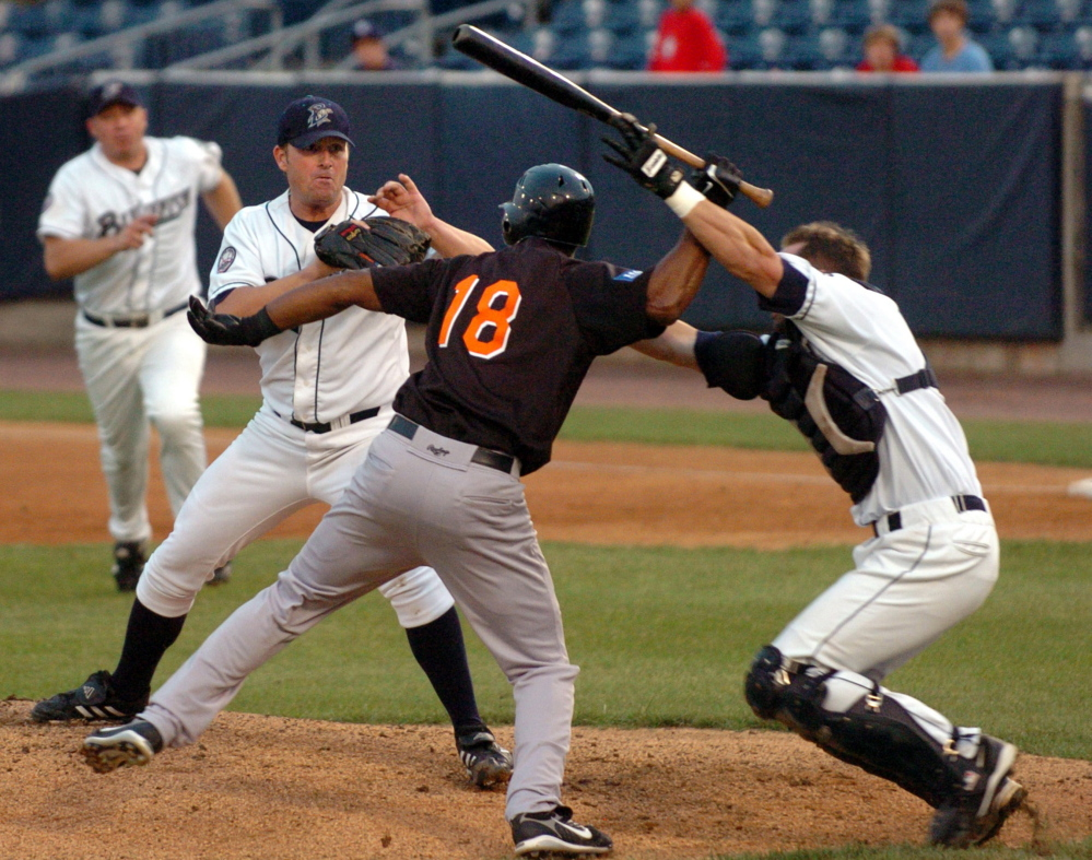 "Bluefish catcher John Nathans, right, tries to stop Long Island Ducks' Jose Offerman from hitting pitcher Matt Beech with a bat during a 2007 Atlantic League game in Bridgeport, Conn. ""I'm known for going out and protecting my pitcher,"" Nathans said. ""I'd rather be known as that guy than the guy who didn't go out, the guy who sat at home plate and watched his pitcher get beat."""