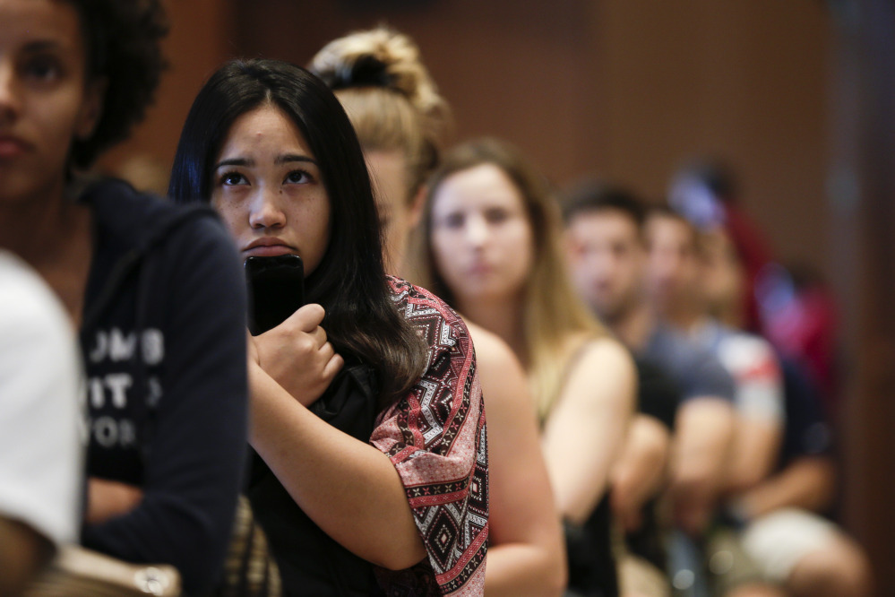 "New students at San Diego State University watch a video on sexual consent during a recent orientation meeting. California legislation would require schools that receive public funds for student financial assistance to set a so-called ""affirmative consent standard."""