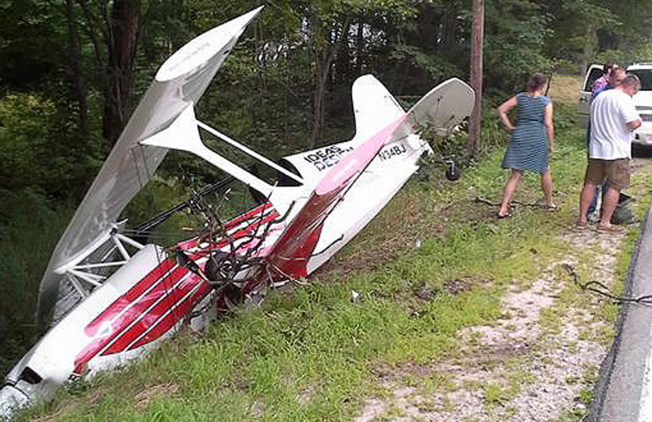 A single-engine plane rests in a ditch beside Rte. 35 in Standish on Sunday. The pilot suffered only minor injuries.