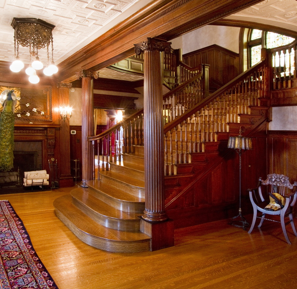The first-floor foyer of the home, like the rest of the mansion, features elaborate tiger maple woodwork. Carl D. Walsh / Staff Photographer