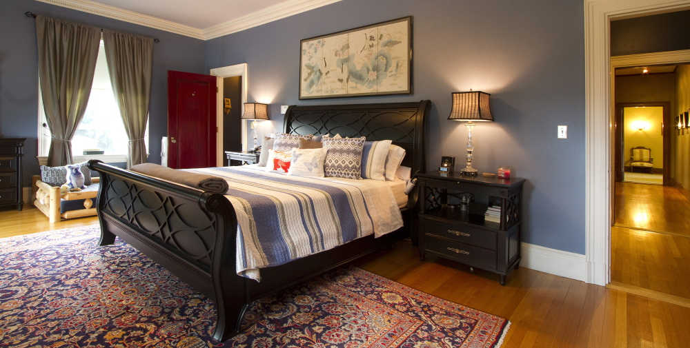 The master bedroom is one of nine in the mansion, which also has 5½ baths and 10 fireplaces.