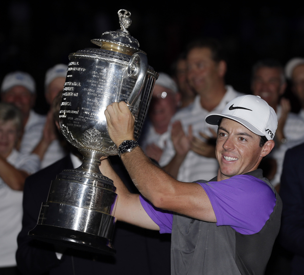 Rory McIlroy holds up the Wanamaker Trophy after winning the PGA Championship on Sunday night at Valhalla Golf Club in Louisville, Ky. McIlroy became one of just four players to win four major championships by the age of 25.